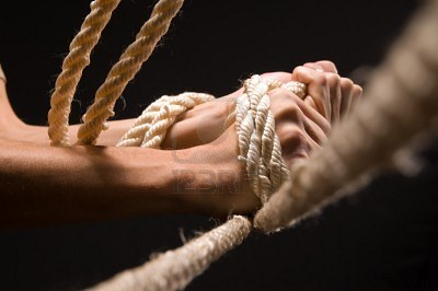 8206594-men-s-hands-hold-tight-rope