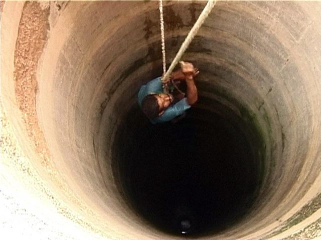 man_well-hanging-by-a-thread-hold-on-struggling-trust-hopeless-lost-helpless-feeling-hanging-by-a-rope-well-water-man-in-well