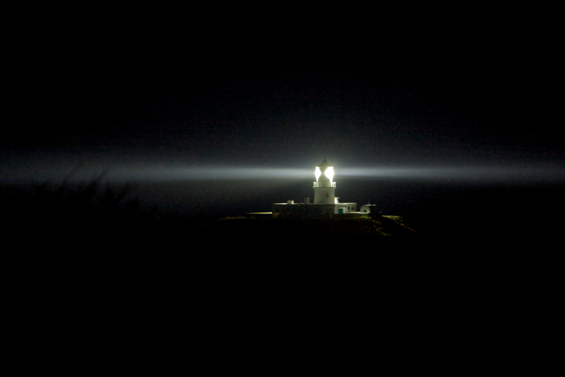 strumble-head-lighthouse-set-dramatically-against-the-night-sky-a-beam-of-light-circling-photo-by-hagen-landsem.jpg