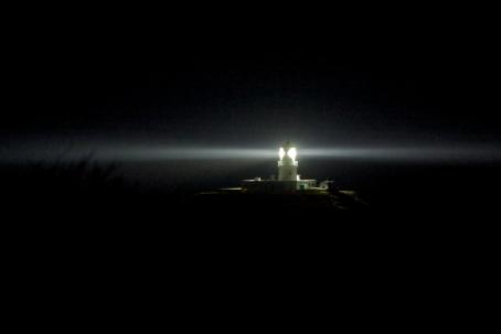 strumble-head-lighthouse-set-dramatically-against-the-night-sky-a-beam-of-light-circling-photo-by-hagen-landsem.jpg